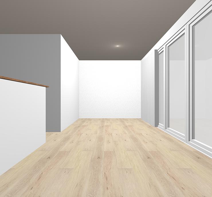 グレイッシュな明るい茶色の床材を貼ったLDK