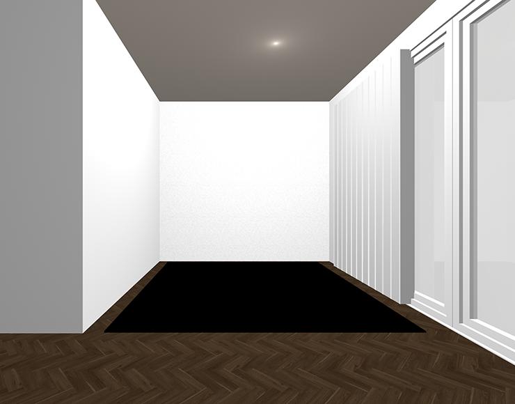 暗い茶色の床と黒のラグ