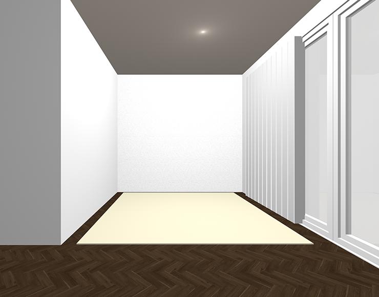 暗い茶色の床と白っぽいラグ