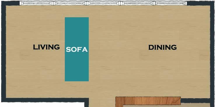 横長リビングのリビングの壁に向けてソファ
