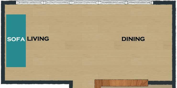 横長リビングのダイニングの壁に向けてソファ