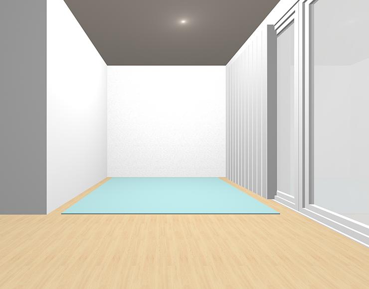 明るい茶色の床と明るい寒色のラグ