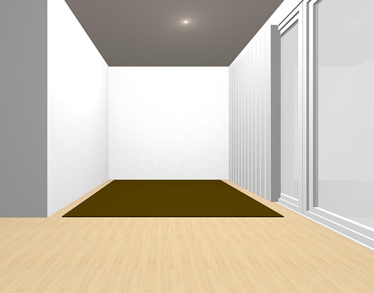 明るい茶色の床と暗い茶色のラグ