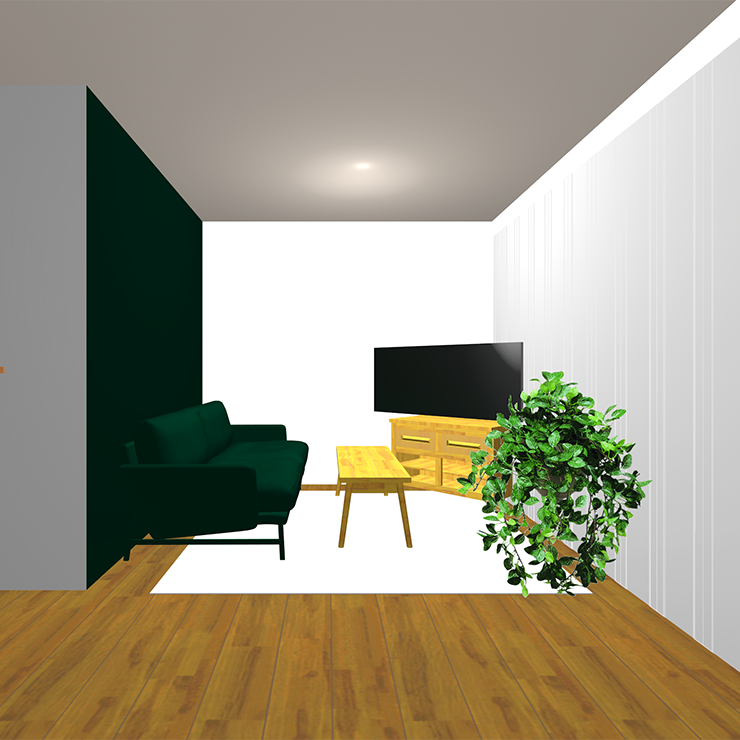 暗い緑のアクセントクロスと暗い緑のソファ