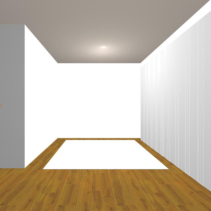 ミディアムブラウンの床と明るいラグ