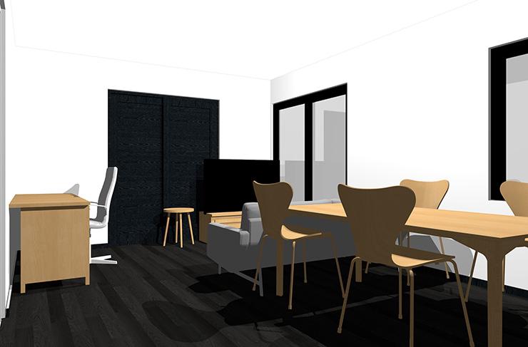 黒の床とライトブラウンの家具