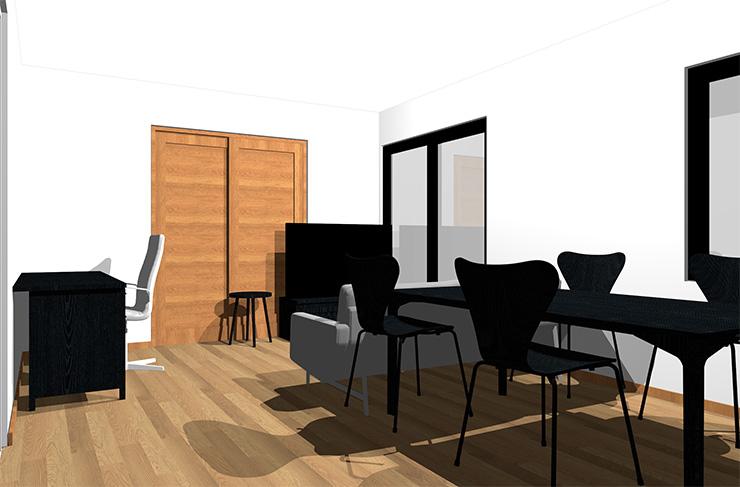 ミディアムブラウンの床と黒の家具