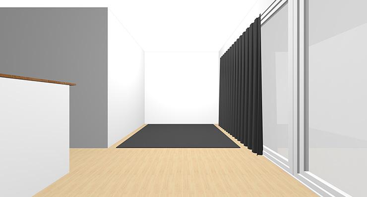 暗いグレーのカーテンと暗いグレーのラグをコーディネートした横長リビング