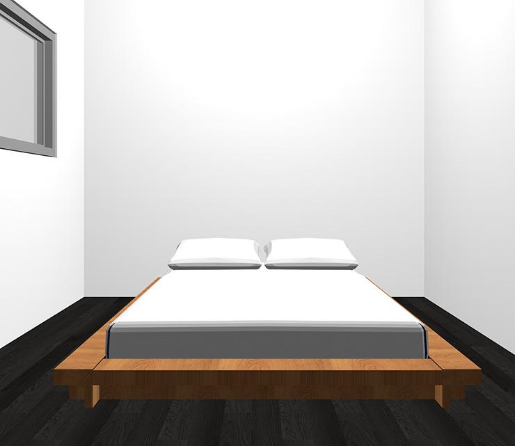 黒の床と茶色のベッド