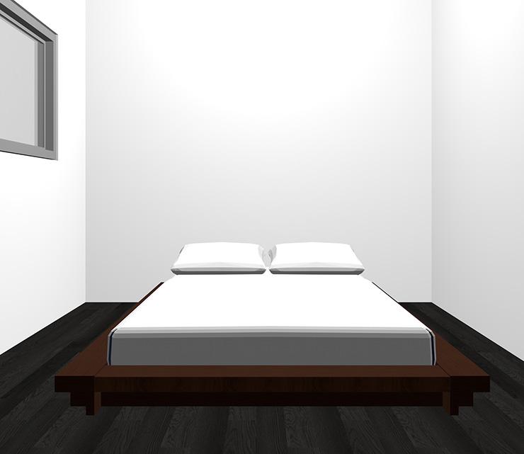 黒の床と暗い茶色のベッド