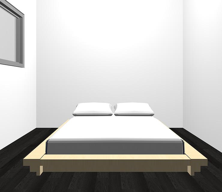 黒の床と薄い・明るい茶色のベッド