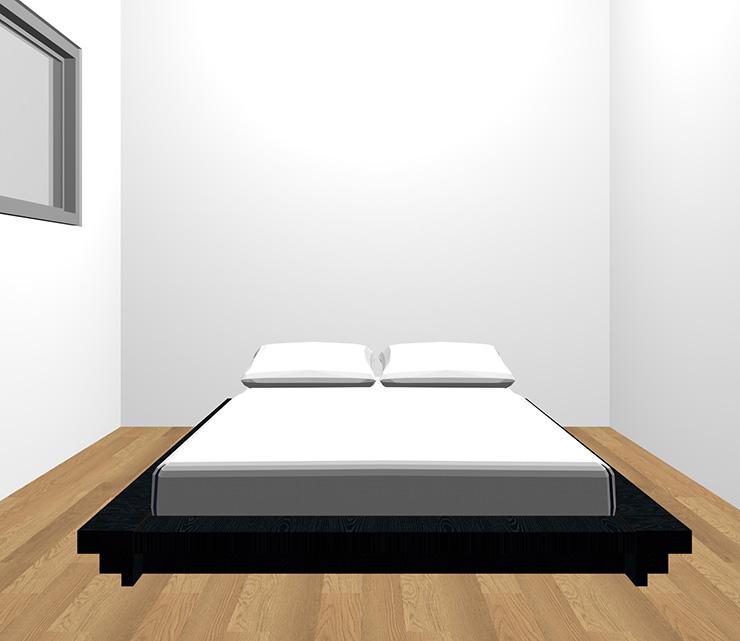 茶色の床と黒のベッド