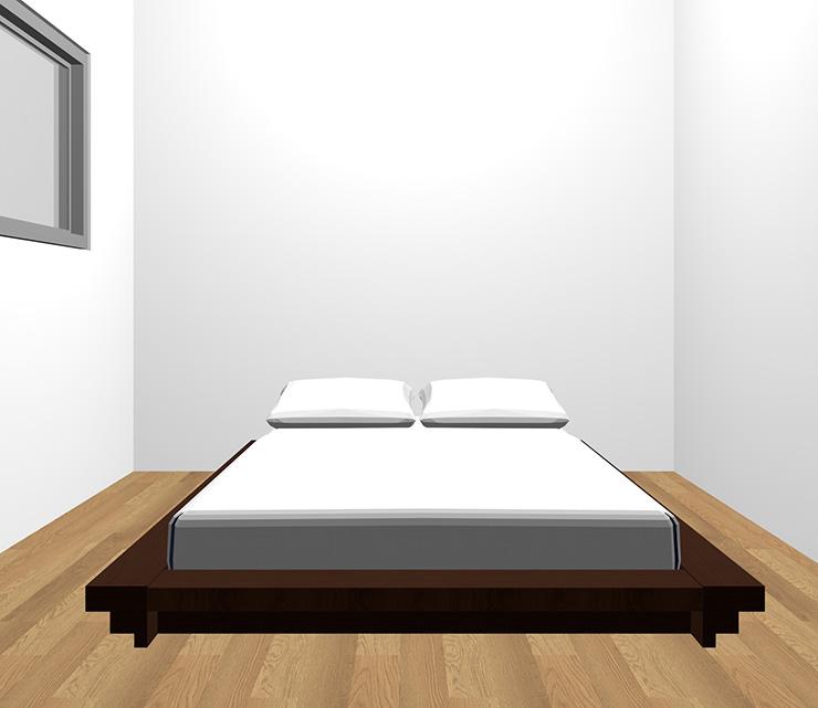 茶色の床と暗い茶色のベッド