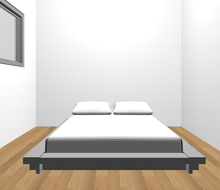茶色の床とグレーのベッド