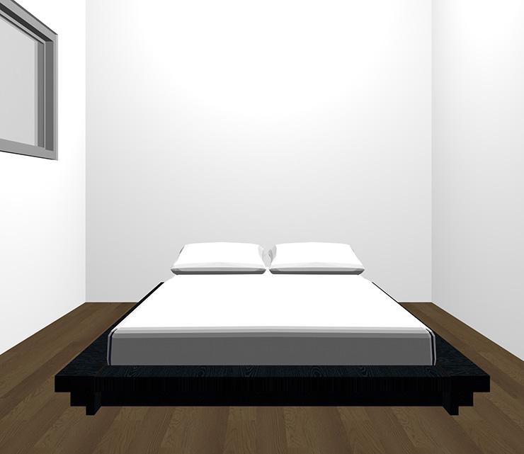 暗い茶色の床と黒のベッド