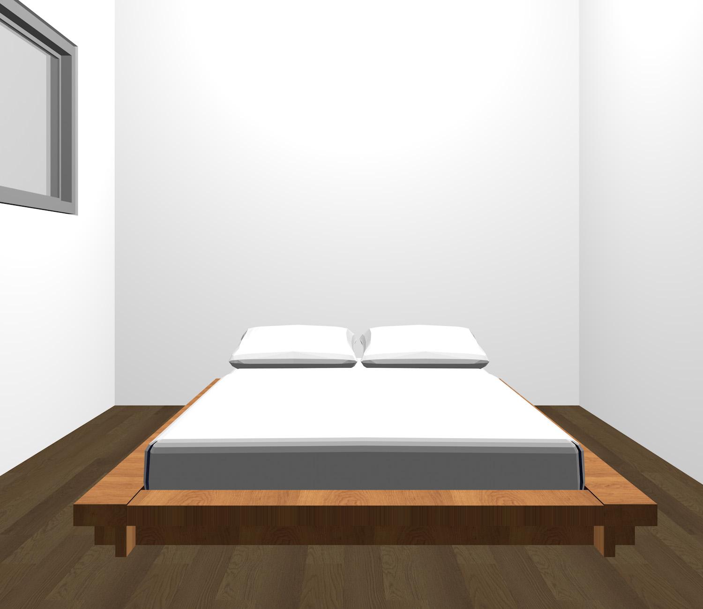 暗い茶色の床と茶色のベッド