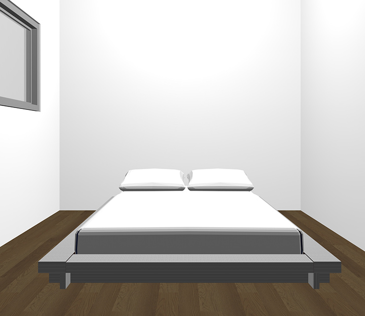 暗い茶色の床とグレーのベッド