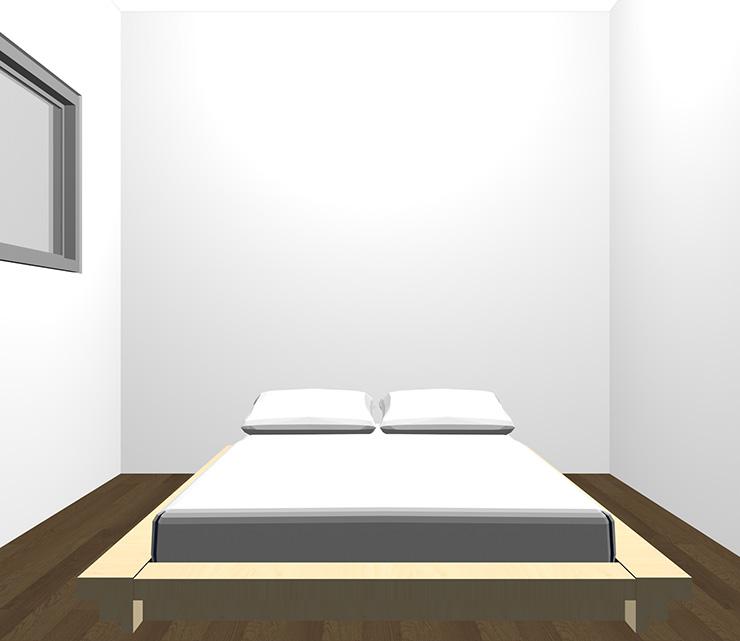 暗い茶色の床と薄い・明るい茶色のベッド
