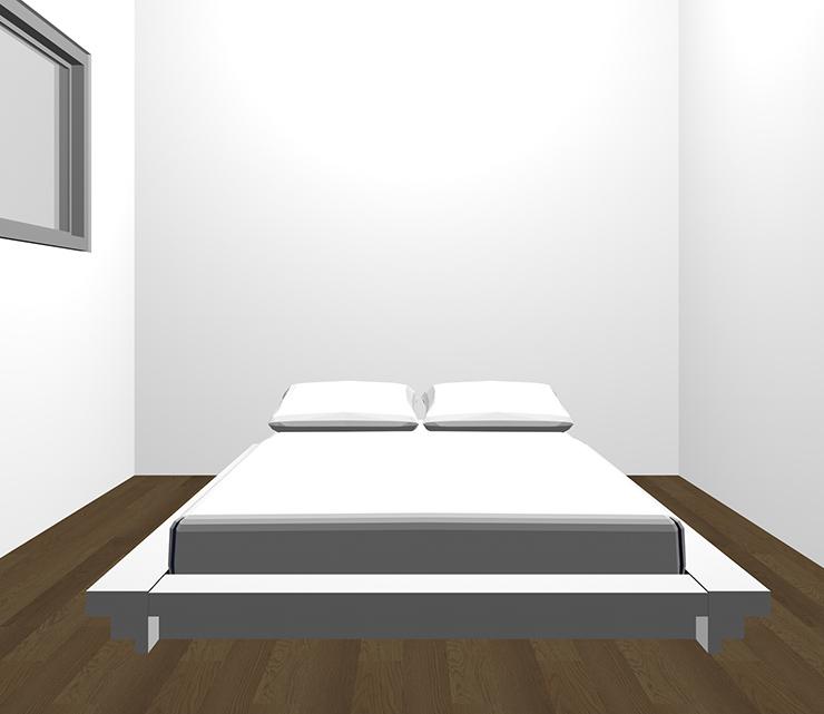 暗い茶色の床とホワイトのベッド