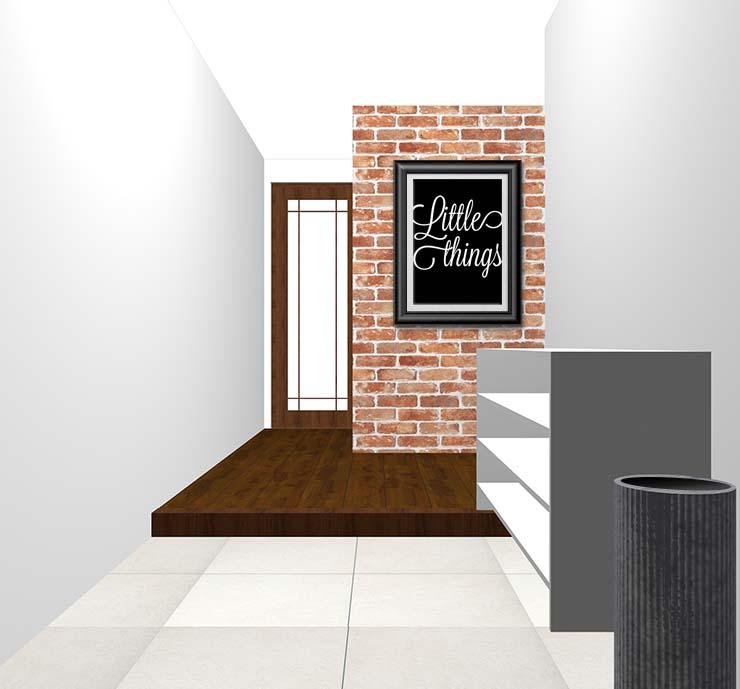 一部がレンガ壁の玄関にモノクロのウォールアートをディスプレイ