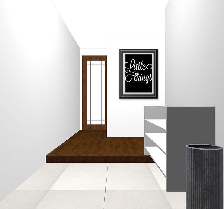 真っ白な壁の玄関にモノクロのウォールアートをディスプレイ