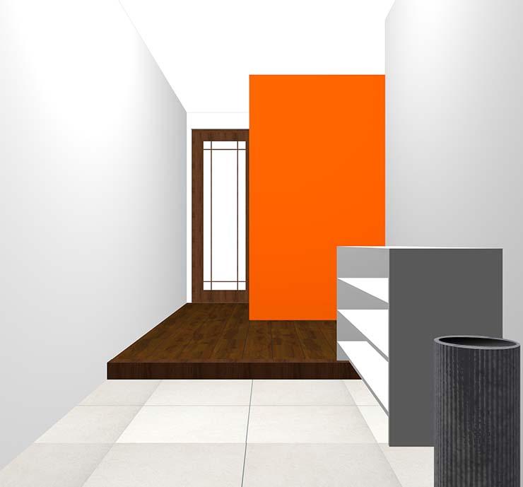 オレンジの壁紙クロス・アクセントクロスの玄関
