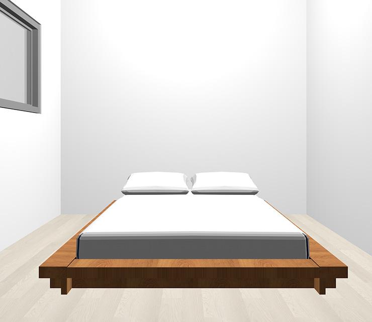 グレーの床と茶色のベッド