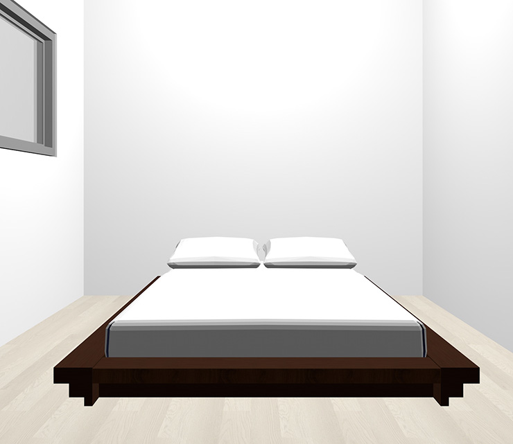 グレーの床と暗い茶色のベッド