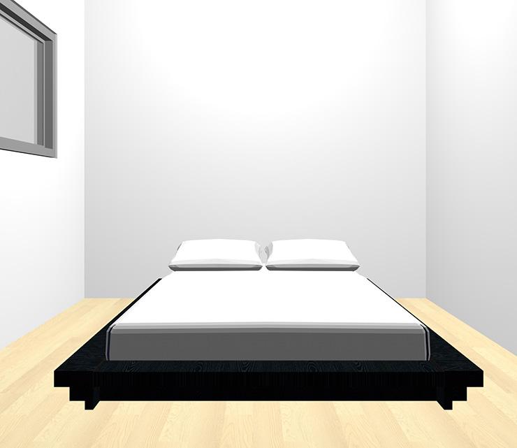 薄い・明るい茶色の床と黒のベッド