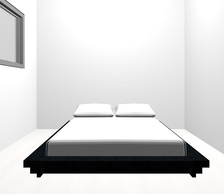 ホワイトの床と黒のベッド
