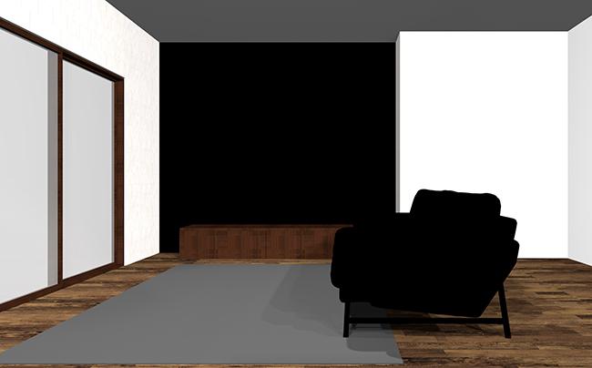 黒のアクセントクロスと黒のソファ