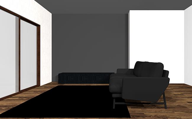 暗いグレーのアクセントクロスとソファ、黒のラグと家具