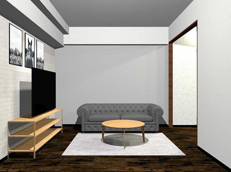 暗いグレーのソファと明るい茶色の家具