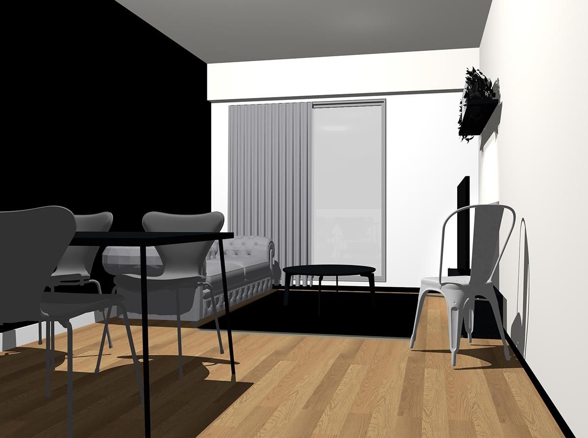 黒の壁紙とグレーのソファ