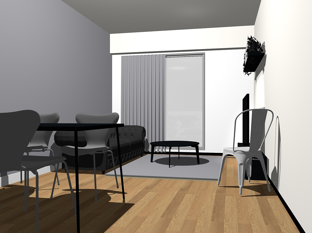 グレーの壁紙と黒のソファ