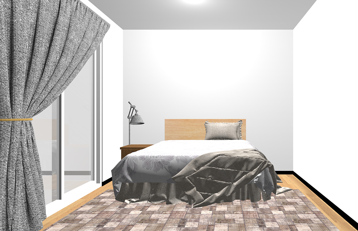 ベッドの下の足側だけにラグを敷いた寝室