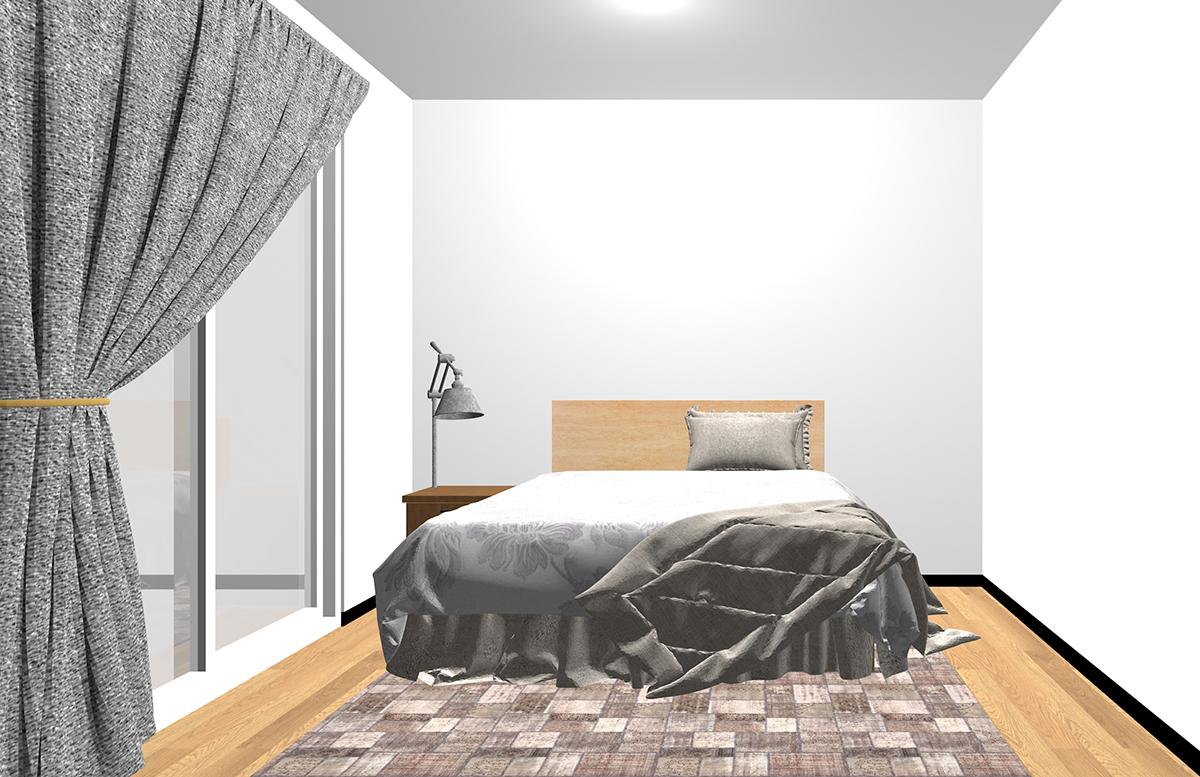 ベッドの下にラグを敷いた寝室