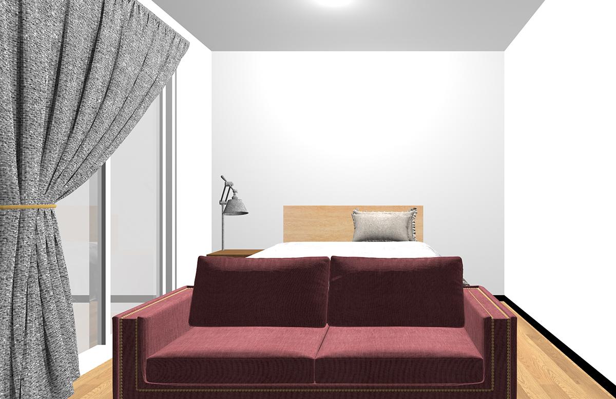 ベッドの足側にソファを置いた寝室