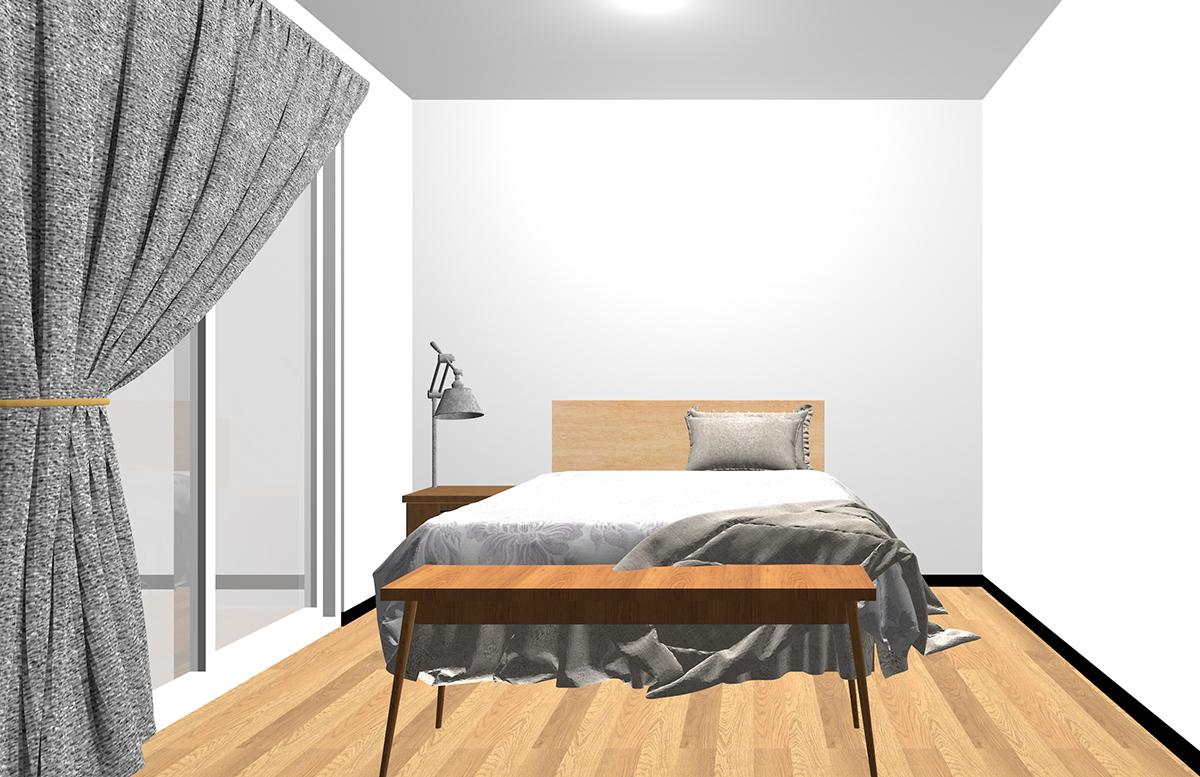 ベッドの足元にテーブルを置いた寝室