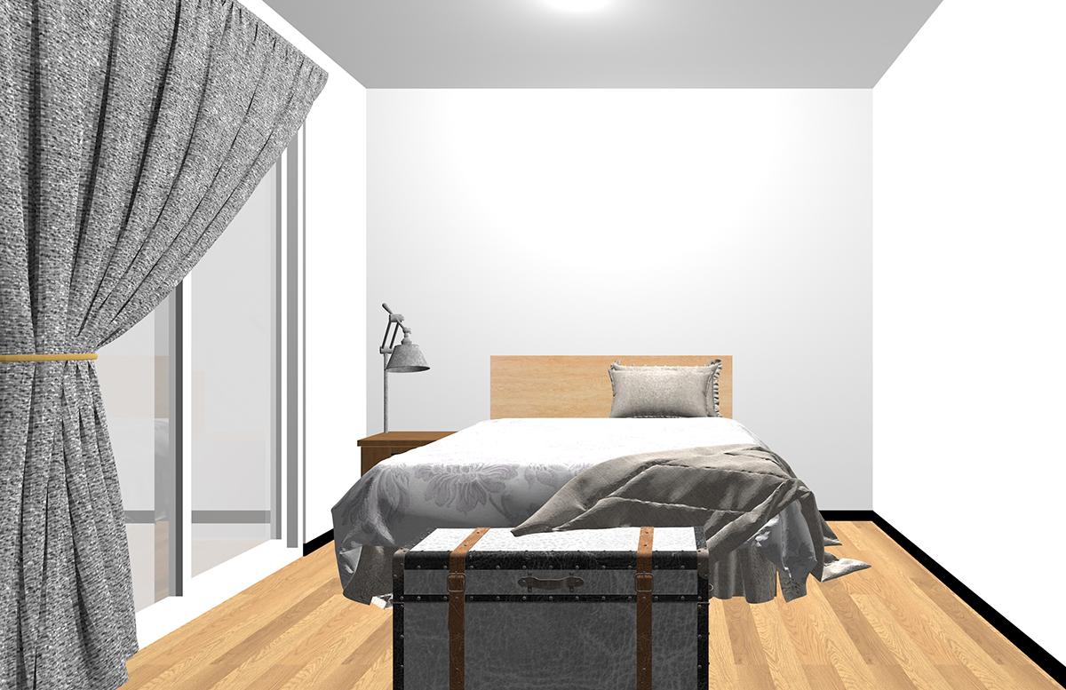 ベッドの足側にトランク型収納を置いた寝室