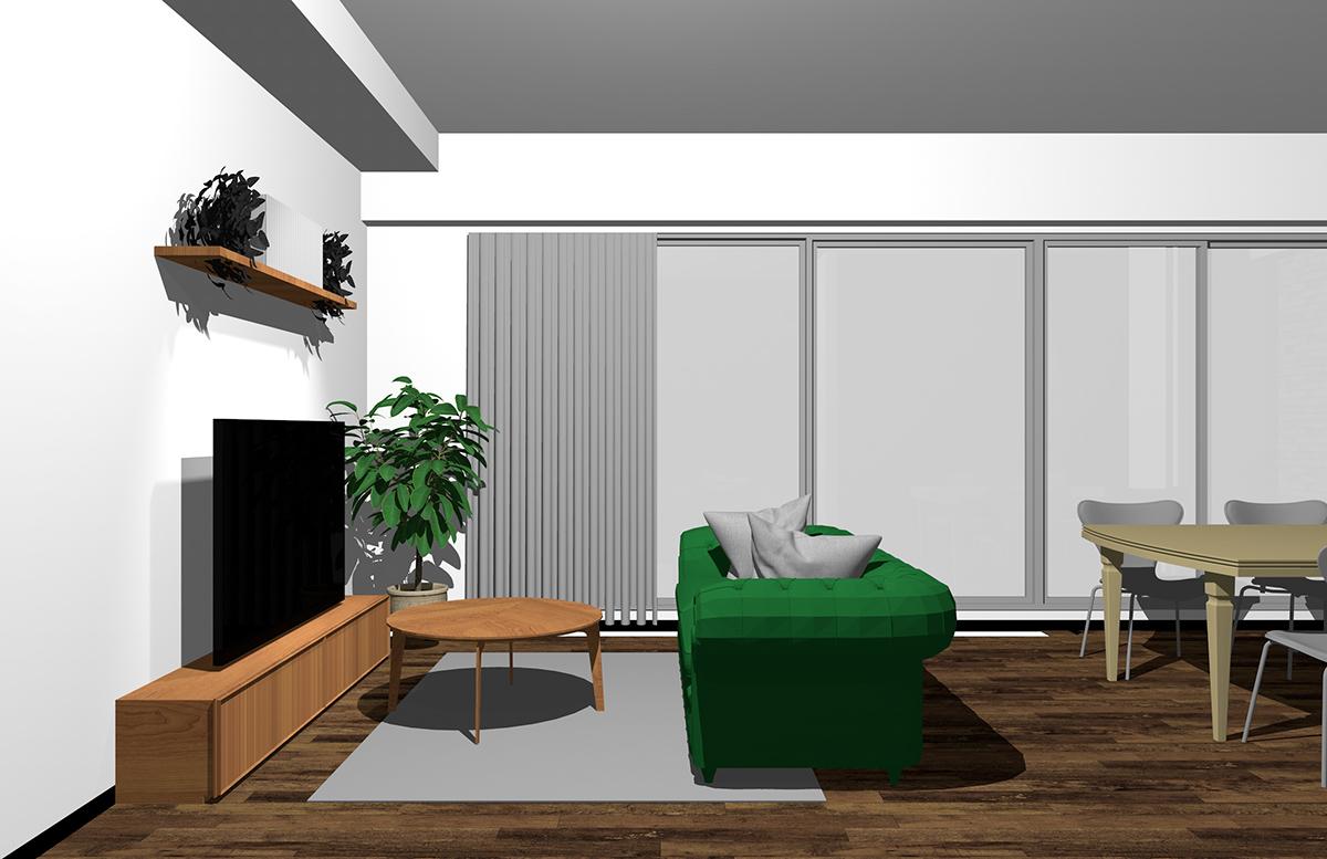ダイニングを背にグリーンのソファ