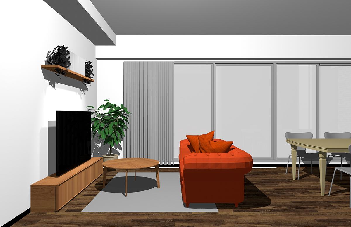 ダイニングを背にオレンジのソファ