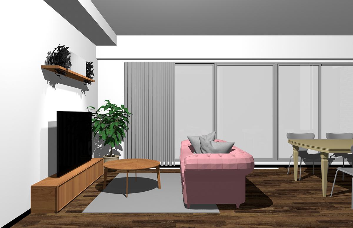 ダイニングを背にピンクのソファ