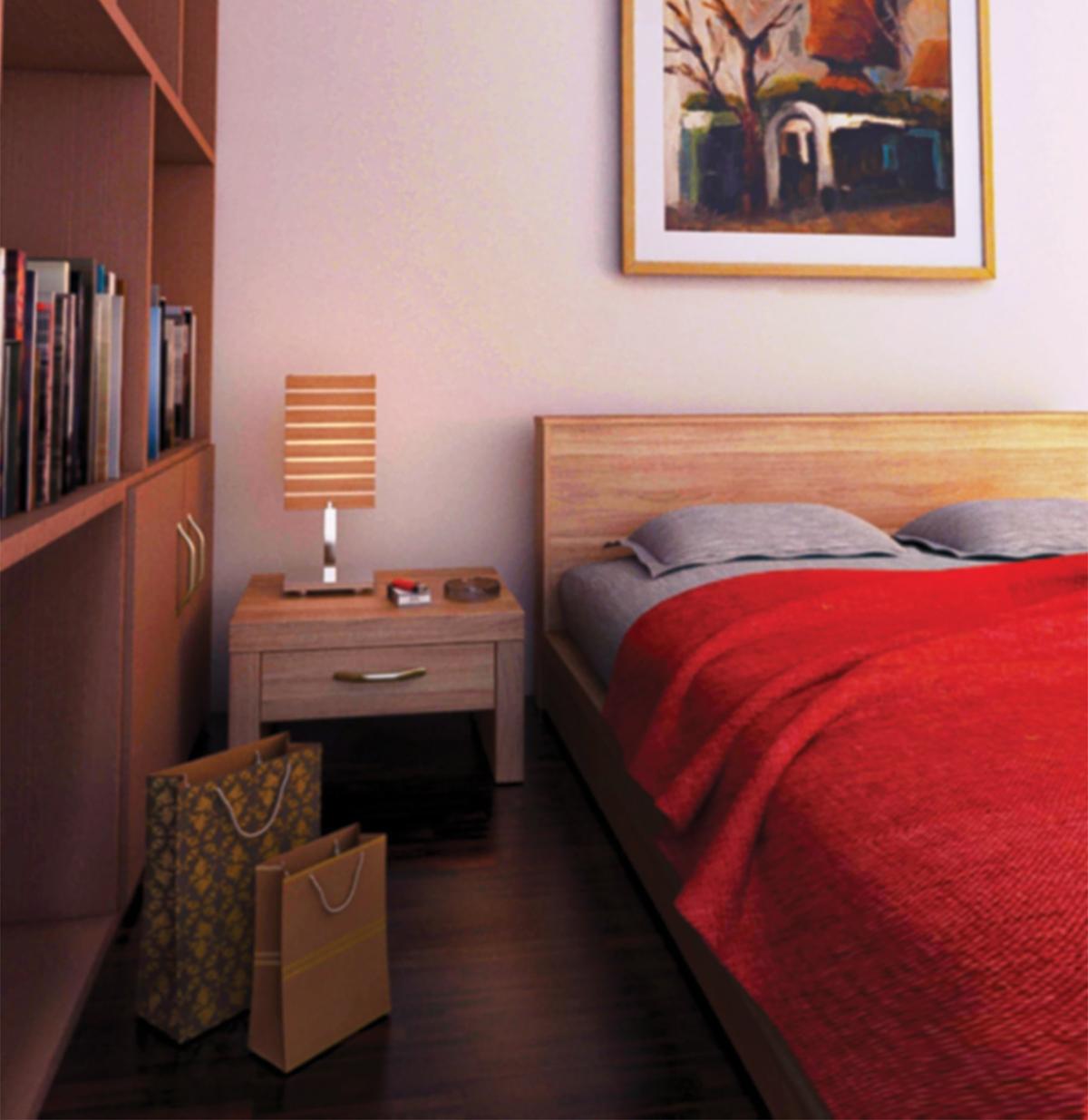 茶色の木目家具と赤のベッドリネンを組み合わせた寝室