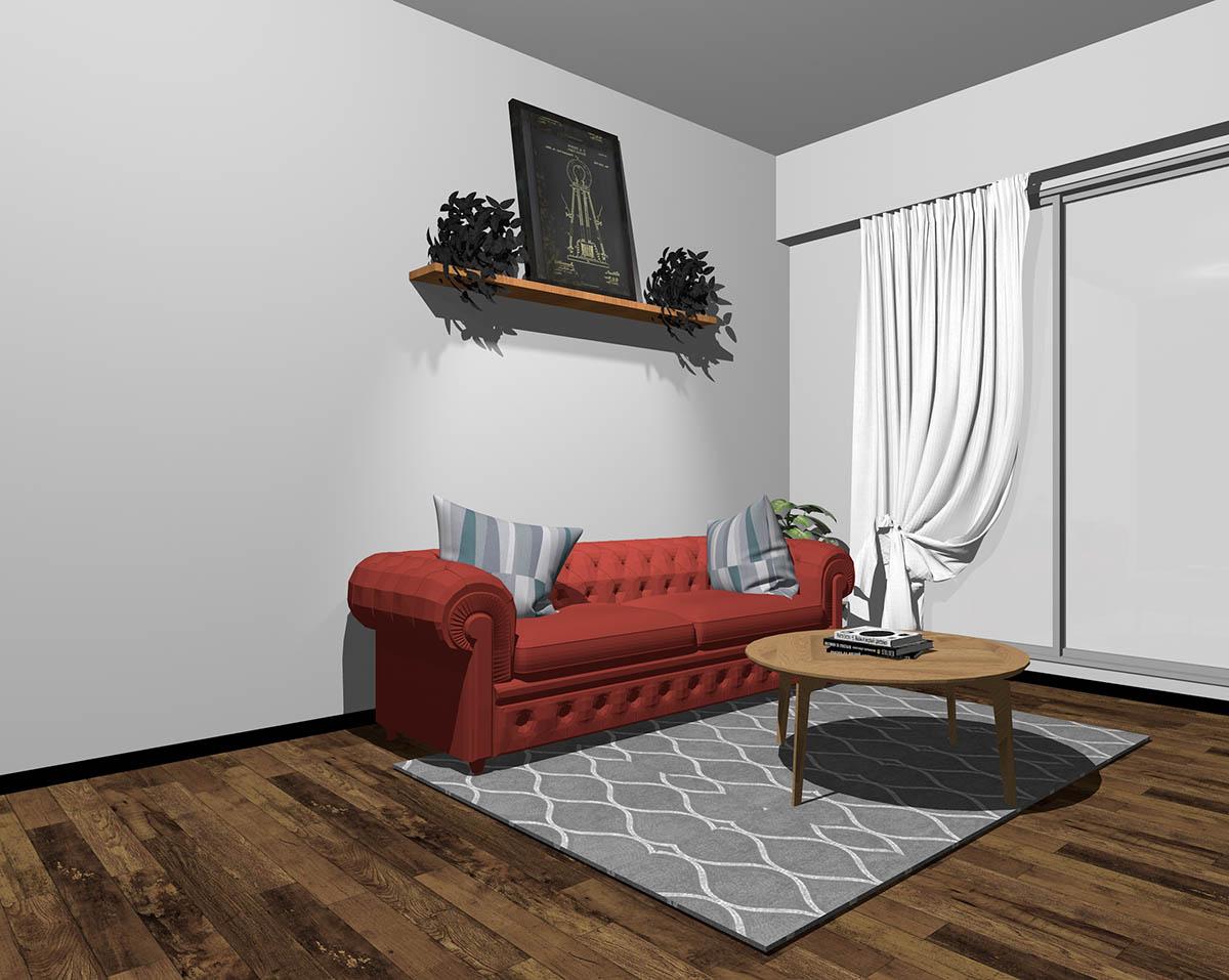 赤のソファとグレーの壁紙のインテリア