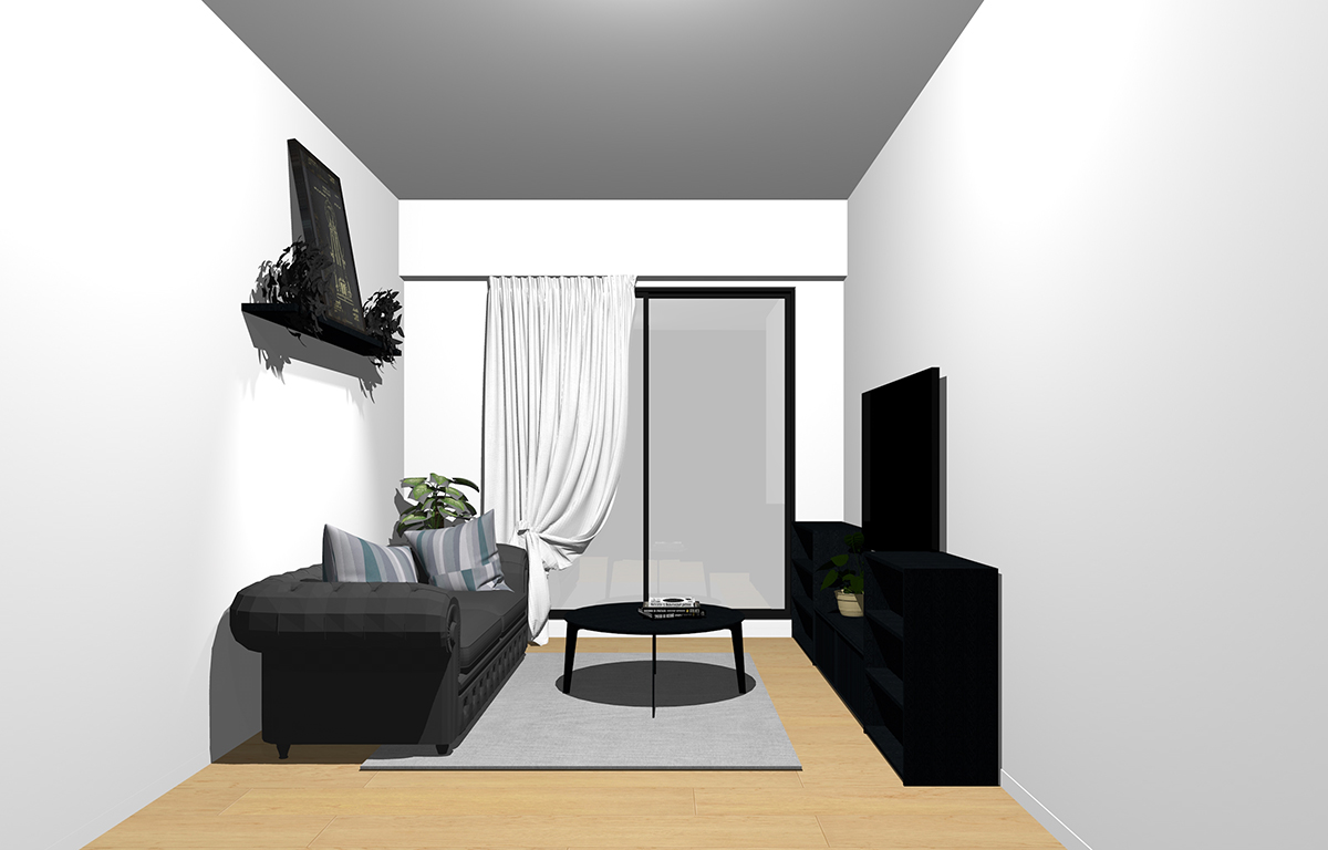 ナチュラルブラウンの床と黒の家具のリビング
