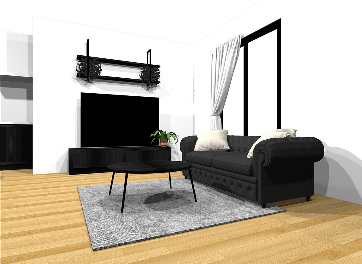 ブラックの家具とナチュラルブラウンの床のインテリア