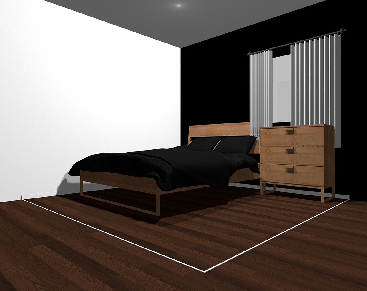 黒でまとめた4畳半の狭い寝室