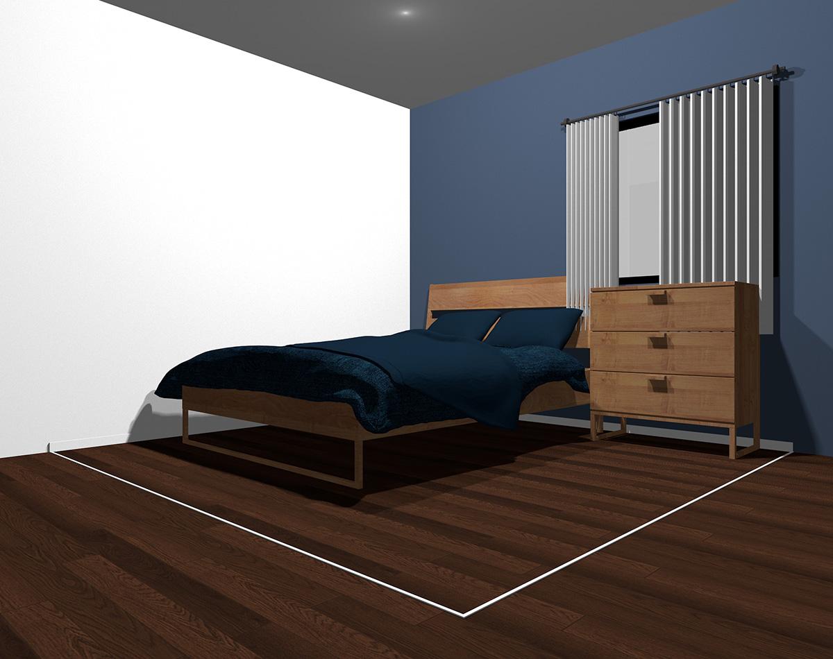 暗いブルーでまとめた4畳半の狭い寝室
