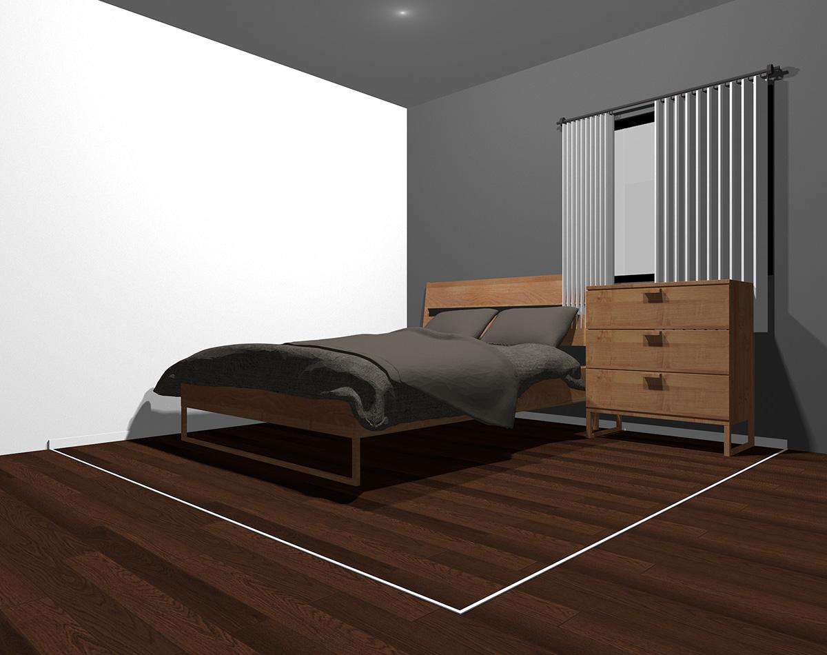 暗めのグレーでまとめた4畳半の狭い寝室